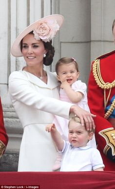 dailymail:  : Trooping the Colour 2016, June 11, 2016-Duchess of Cambridge with her children Princess Charlotte, making her balcony debut, and Prince George, wearing the outfit his father Prince William wore to Prince Harry's christening in 1984