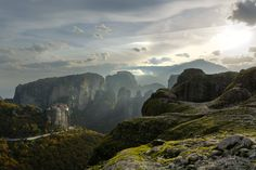 """RayLigion - What's better than a partly sunny sky combined with high fog ? Sun Rays of course!  Location: Meteora ( monastery complex built on top of grand canyon-like rock formations ) in Kalabaka, Greece.  The sun is breaking through the clouds, shinning its light upon the Roussanou monastery in the background. The clouds and the cliffs between the sun and the monastery created some nice sun rays ( thus """"(sun)RayLigion"""" )."""