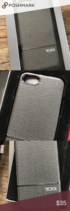 """TUMI Two-Piece Slider Case iPhone 7 Grey/Gunmetal! TUMI Two-Piece Slider Case for iPhone 7 Grey/Gunmetal!     This sleek and stylish two-piece slider case ensures durable protection and makes slipping for phone in and out an effortless transaction. The Grey/Gunmetal case has some scuffing around the camera lens opening and along the metal areas at the seam of the two pieces. Still in fabulous working order! Comes in its original box.  Grey/Gunmetal     Dimensions: 5.5"""" H x 3"""" W x .5"""" D…"""