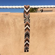 This Annie Oakley Autumn Loom bracelet is a 100% ORIGINAL PuebloAndCo design; I am inspired by all the beautiful Native and Latin American patterns I see around me in Albuquerque, New Mexico. As with all my pieces, Ive created it on a bead loom with great care and attention to detail. IMPORTANT NOTE: Please measure your wrist carefully before order placement, to ensure a proper fit. These bracelets are not adjustable.  The beads used in this piece are my favorite - high quality glass…