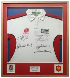 Rugby World Cup Shirt    Our customer had a great trip to France to watch the 2007 World Cup.   We framed this shirt signed by the captains, and also decided to put the two country emblems in the frame to add interest and impact