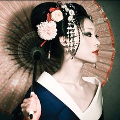 Geisha - Fiona Graham, caucasian Geisha as of 2007.  Beautiful, smart and brave enough to immerse herself in a completely different culture.  Inspiration much?
