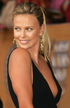 Charlize Theron, a modern classic beauty, star of The Devil's Advocate, The Italian Job, and Mad Max: Fury Road.
