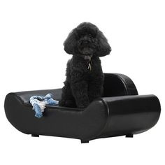 open with a back style Sofa-shaped pet bed with faux leather upholstery.  Product: Pet bedConstruction Material: Wood and fabric