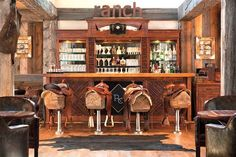 How fun! Western decor for the cabin. Love the saddle seats at the bar.