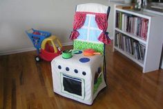Kids Kitchen Slipcover - cutest play kitchen ever. Love how adorable it is AND practical. A fabulous play kitchen for small spaces! Kids Crafts, Diy And Crafts, Craft Projects, Sewing Projects, Quilting Projects, Play Kitchens, Sewing For Kids, Diy For Kids, Slipcovers For Chairs