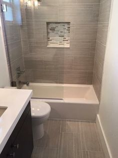 We love oversized subway tiles in this bathroom! The ...