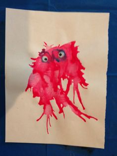 Blow paint monsters. Using an eyedropper, toddlers squeeze out some paint onto paper and blow through a straw and add googlie eyes to create these adorable little mosters.