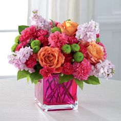 Dazzling and delightful, this bold and colorful flower bouquet is set to impress with it's high impact look and graceful styling.  send The FTD® Color Rush™ Bouquet www.americasfloristnyc.com