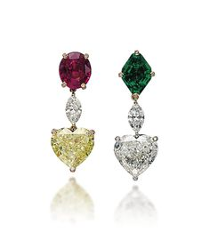 A PAIR OF DIAMOND, COLOURED DIAMOND, RUBY AND EMERALD EAR PENDANTS, BY DE GRISOGONO One with a heart-shaped diamond, weighing approximately 5.08 carats, suspended from a marquise-shaped diamond to the lozenge-shaped emerald top, weighing approximately 2.01 carats, one with a fancy intense yellow heart-shaped diamond, weighing approximately 5.13 carats, suspended from a marquise-shaped diamond, to the oval-shaped ruby, weighing approximately 3.56 carats, mounted in gold. Signed de Grisogono