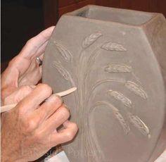 Slab vase with raied texture