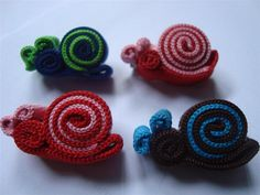 Brooch made from shoelace, snail shape. Can be customized to be hairpins, key chains, cellphone chains, and hair tie. Contact me at +6285 729 454 260
