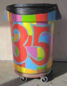 Maybe if I paint my garbage can like this it won't keep disappearing!