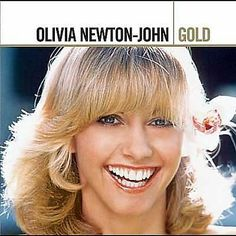 I just used Shazam to discover Hopelessly Devoted To You by Olivia Newton-John. http://shz.am/t5160950