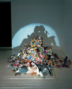 This is a series of strategically lumped together garbage that casts some seriously cray cray shadows. The project was created by artists Tim Noble and Sue Webster and is a MUST SEE.