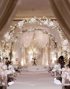Lovely arches decorated with lights, greenery and white floral accents make a beautiful setting for a romantic wedding~ A Dream Wedding!