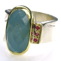 The wrinkled band: Silver 925, Gold k18, Faceted aquamarine, rubies