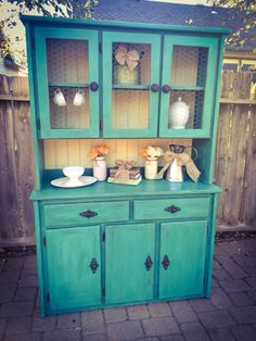 Annie Sloan florence with cream back hutch. Dark and clear wax.