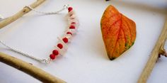 This necklace combines the delicacy of the white moonstone and the passion of red beads.  The vivid colour gives characted to these jewel. As ancient as the moon itself, Moonstone holds the power of mystery. Its secrets are locked beneath a pearly veil. Moonstone is foremost a talisman of the inward journey, taking one deep into the self to retrieve what is missing, the parts of the soul left behind or forgotten, then brought to light again.
