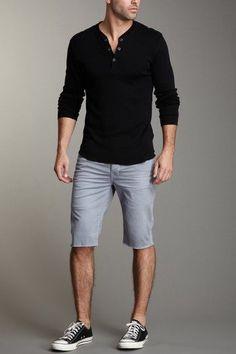 Shop this look on Lookastic: https://lookastic.com/men/looks/black-henley-shirt-grey-shorts-black-and-white-low-top-sneakers/12256 — Black Henley Shirt — Grey Shorts — Black and White Low Top Sneakers