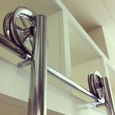 Rolling ladder -curved corner to acces multiple walls -easier access to high shelves