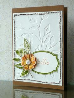 embossing folder with cut out leaf/flower sprig