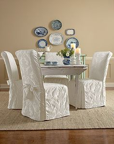 Elegant White Dining Room With Relaxed Fit Chair Covers