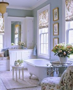 Pretty and traditional blue and white master bathroom with claw foot tub.
