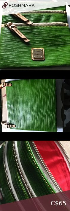 """Dooney & Bourke Triple Zip Green Crossbody Bag Beautiful Dooney & Bourke green crossbody purse. Two outside zipper pockets. Colourful fabric lining, gently used condition. Perfect pop of colour. *NOTE: last photo not of item but to show how long strap is* Adjustable strap. Strap drop length 24"""". Approximately measures H 8"""" x W .5"""" x L 8"""" and weighs 11 oz Dooney & Bourke Bags Crossbody Bags Dooney And Bourke Disney, Dooney Bourke, Emily Giffin Books, Leather Crossbody Bag, Crossbody Bags, Hello Kitty Dress, Disney Purse, Color Pop, Colour"""
