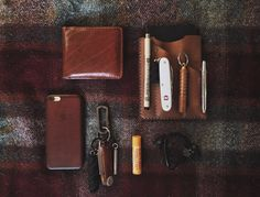Tess' worn leather and multi tool EDC  submitted by Tess  Apple Cell Phone Case for iPhone 6 & 6s Saddle Brown  Urban EDC Supply Urban Organizer Tan  Moleskine Cahier Journal Soft Cover (3.5 x 5.5) Black  Fisher Space Pen Classic Finish Chrome Bullet Ballpoint Pen  Prometheus Lights Beta-QRv2 Copper  Victorinox Pioneer X Multi Pocket Knife with Scissors Silver Alox  Wazoo Survival Gear Fishing Kit Zipper Pull  Wazoo Survival Gear Wire Saw Keychain  Premium Leather Orbitkey 2.0 Cognac with…