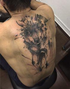 Watercolor wolf tattoo on back by Zanotto