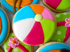 Summer decorated sugar cookies. Royal icing. Red, blue, orange, pink, white, green. Beach ball, round, flip flop. Polka dots.