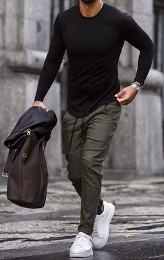 There is no time like the present to step up your style game! What's your thoughts on this outfit gentlemen? Black sweater with olive green pants mask white sneakers, don't forget the brown and black leather biker jacket. Mens Casual Dress Outfits, Formal Men Outfit, Casual Wear For Men, Stylish Mens Outfits, Stylish Clothes For Men, Man Clothes, Summer Outfits Men, Casual Attire, Outfit Summer