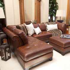 Tufted leather sectional sofa in bourbon with a hardwood frame.  Product: Left-arm-facing sectional sofaConstruction Mate...