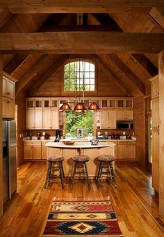 love this log home kitchen, especially that big window up high
