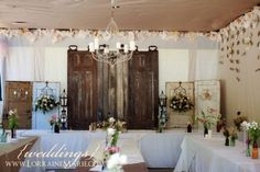 These vintage doors make a beautiful backdrop for the reception head table. These vintage doors make a beautiful backdrop for the reception head table. The lanterns and antique sconces are the ici. Vintage Wedding Backdrop, Wedding Reception Backdrop, Ceremony Backdrop, Wedding Backdrops, Vintage Weddings, Wedding Ceremony, Rustic Wedding Centerpieces, Wedding Decorations, Wedding Ideas