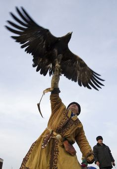A hunter in Qazaqstan releases his tame golden eagle.