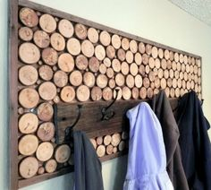 coat rack from upcycled wood discs. rustic and clean. perfect for the entryway?
