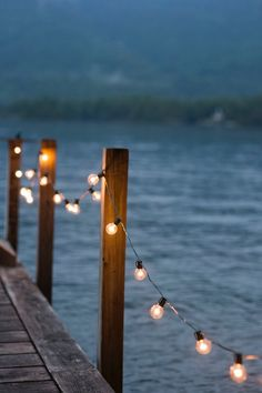 Nicole asks Gabby to take pictures of her and Ryan on the town dock. Fairy lights led them to the end where there was a beautiful black arch covered in ivory and more fairy lights created.