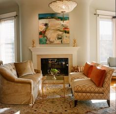 Like the sofa, chairs, rug, colors- arrangement centered on the fireplace