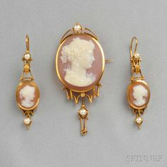 Antique 18kt Gold and Hardstone Cameo Suite, comprising a brooch and earpendants each set with a cameo depicting a maiden with upswept hair, with pearl accents, and suspending drops, lg. 2 7/8, 1 7/8 in., boxed. Victorian or Victorian style.
