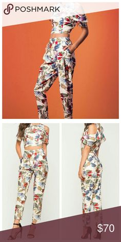 (S,M) Two piece Pant Set All over leaf print two piece pant set.  Cropped top with tiered ruffle sleeves & an elasticized waist. High waist pant features hip pockets & cropped ankle. Non-stretch material Pants