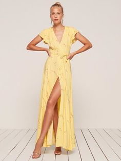 For that thing this weekend. This is a floor length, wrap dress with a cap sleeve and a high slit.