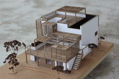 Wooden architecture model for -Les Comptoirs de l'Architecture- by Malet Thibaut. Handmade with cork and walnut. Scale 1/60. Arch2O