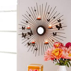 Butterfly Burst Wall Sconce- A flight of fancy for any wall! Dainty winged wonders flutter on our sunburst metal sconce with mirror center and six glasses
