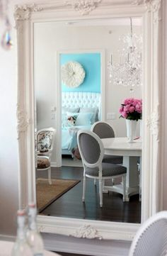 Large mirror. Also love the pops of pink and blue