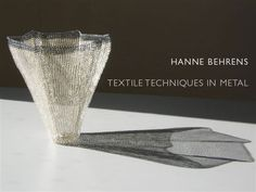 Hanne Behrens: Textile Techniques In Metal  Danish artist Hanne Behrens creates exquisite geometrical jewelry and vessels woven from silver and gold wire. A student of Arline Fisch and Mary Lee Hu, she is a master of textile techniques such as weaving, knitting and plaiting. In 2000 she was commissioned to make a brooch as a gift to Queen Margrethe of Denmark on her 60th birthday. She is the recipient of numerous grants and awards