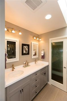 Take a look at this transitional bath remodel from The gray cabinets and Top Knobs Sanctuary cabinet hardware in black complete the design. Thanks for sharing! White Counters, Grey Cabinets, Contemporary Bathrooms, Bath Remodel, Bathroom Inspiration, Midcentury Modern, Design Projects, Interior Design, Counter Tops