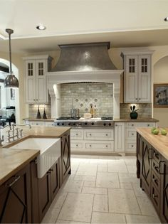 This range hood speaks to me... not too busy or ornate, but it definitely makes a statement.