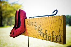 Follow the yellow brick road sign